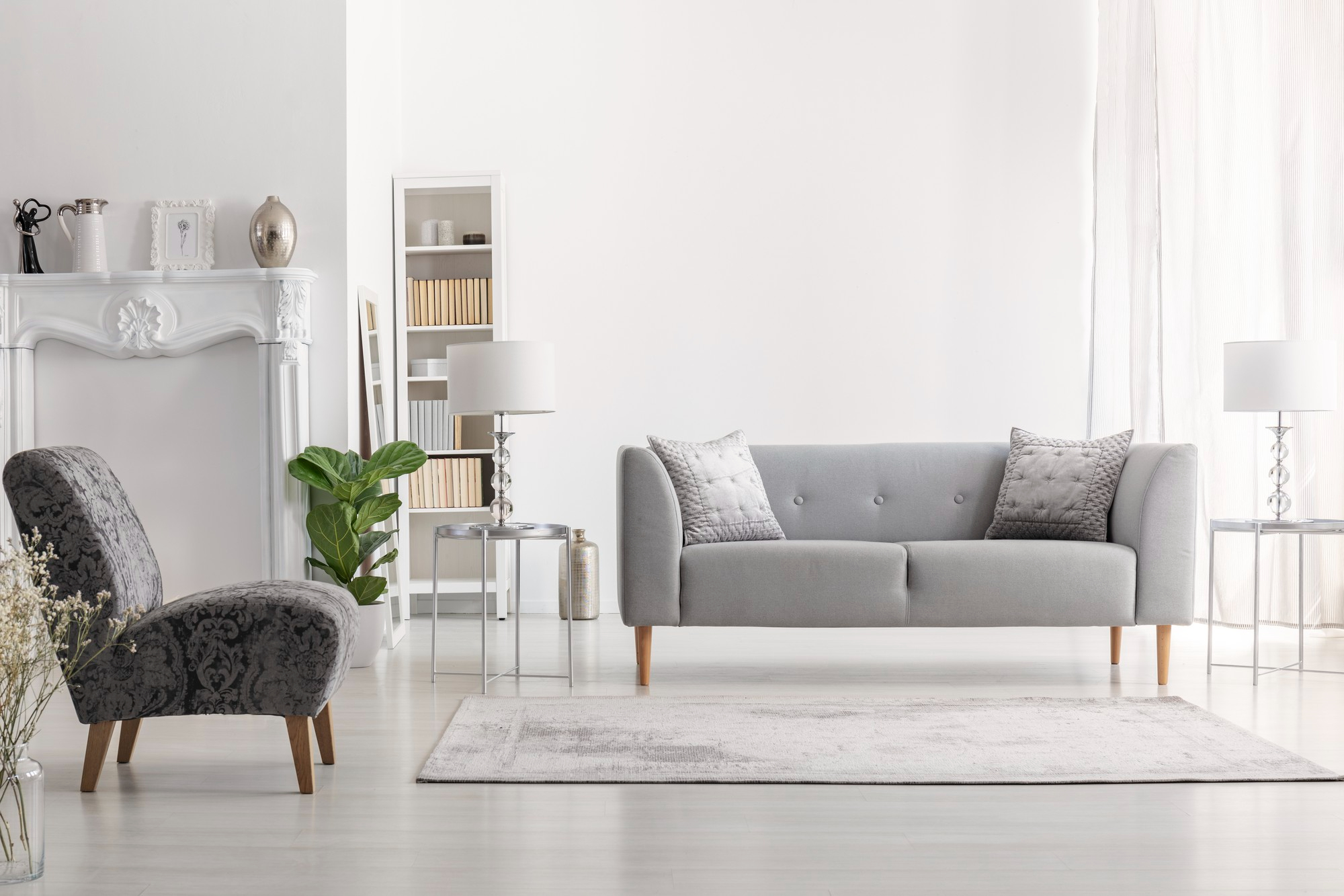 carpet-near-armchair-grey-settee-white-living-room-interior-with-lamp-table-real-photo